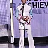 Accepting the lifetime achievement award on stage at the 2010 BET Awards.