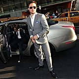 Ed, looking sharp as ever in a gray suit and aviators; that matching silver car is quite the accessory!