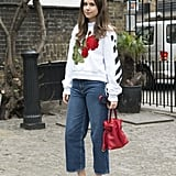 With a cool sweatshirt and equally cool heels
