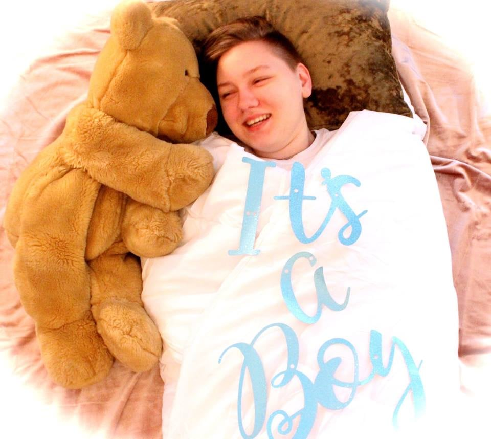 """""""It's a boy!"""" reads a giant blanket a 20-year-old is swaddled up in, in a photo on his mom's Facebook page. After Adrian Brown came out to his mom as transgender, Heather Lundberg Green decided to go all out for her son's birthday, orchestrating an entire gender reveal photo shoot complete with aforementioned adult swaddle, blue balloons, and even a faux baby bump she sported under her own shirt. """"When your child comes out as trans, the best thing to do is create a photo shoot to celebrate the fact that he silently and bravely stepped out of the race that he never wanted to be in, found his own lane, and proceeded to win,"""" Heather wrote in her moving Facebook post. """"HAPPY 20TH BIRTHDAY, Adrian! You are without a doubt the most fascinating human I know and I will always be your biggest fan! I love you, I honor who you are, and I respect your courage to be unapologetically you!! Let's celebrate!!"""" Even though Adrian originally thought that some of the photo ideas seemed a little """"corny,"""" he went along with the fun shoot anyway, and Heather hopes these photos they shared will make a difference. """"The transgender community is under attack by our president, for goodness sake. These people who are transitioning are not receiving the honor and praise that they are due,"""" Heather told USA Today. """"The courage it takes to step out and live their truth while so many people are waiting to knock them down is amazing to me. I hope that by sharing our story, the transgender community will allow themselves to expect celebrations and that they will no longer feel that they are infringing on anyone else by sharing their journey."""" See the incredible photos of this supportive mama and her son ahead.      Related:                                                                                                           How I Talked to My 11-Year-Old Sister About Being Trans"""