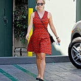 She edged up her printed 10 Crosby Derek Lam sundress with rocker Valentino flats and her signature Ray-Bans.