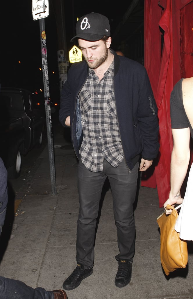 Robert Pattinson hopped into the back of a car with a female friend in LA last night. Rob and 27-year-old actress Sarah Roemer were out for the evening at La Poubelle bar, where they apparently met up with pals. Sarah starred alongside Rob's girlfriend, Kristen Stewart, in the 2007 short film Cutlass and also had a part in Disturbia with Shia LaBeouf. Rob returned to California this week after a stint in London with Kristen. She's in the UK filming Snow White and the Huntsman, though the duo made time for date nights when she wasn't working.  Rob and Kristen are wrapping up a busy year that included the huge success of Breaking Dawn Part 1 and plenty of sweet interactions between the couple. They're currently taking the lead in our favorite celebrity PDA moment of 2011 poll, but there's still time to vote on that and all of our Best of 2011 coverage!