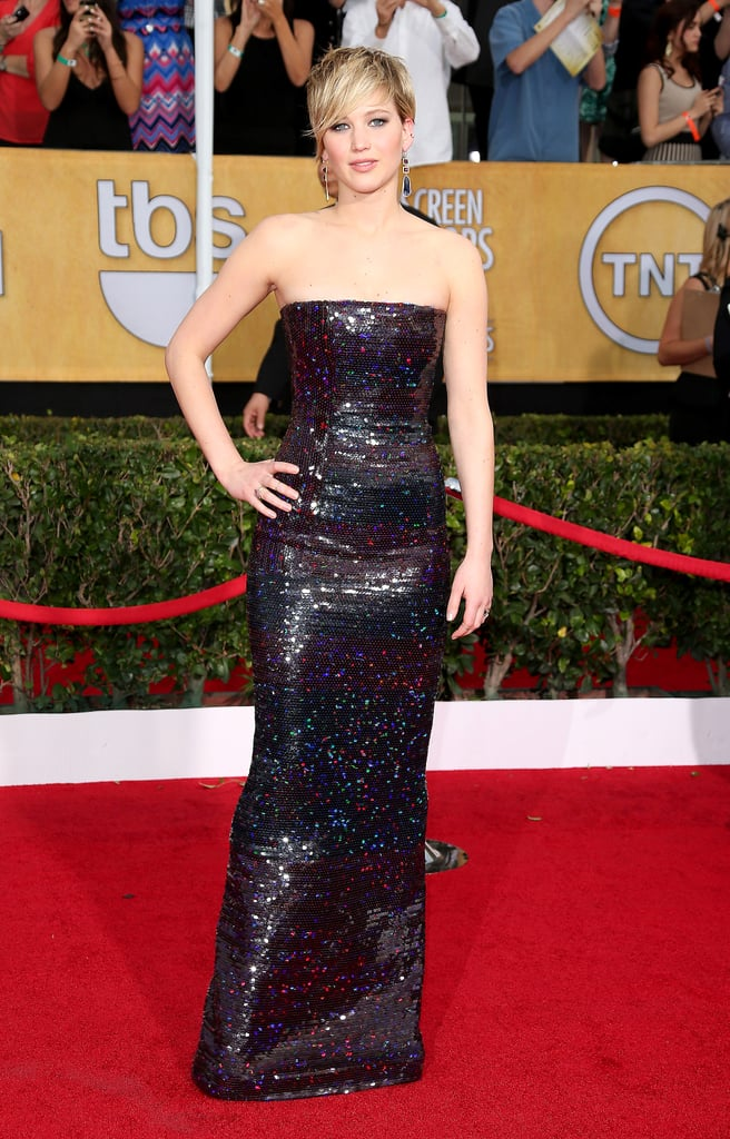 Jennifer always smolders in formfitting looks, like this strapless, sequined Dior gown that she wore to the 20th annual SAG Awards.