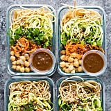 Whole-grain pasta, zoodles, carrots, chickpeas, and a side of spicy almond butter sauce.