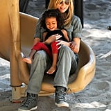 Heidi Klum took a ride on the slide with Lou Samuel.