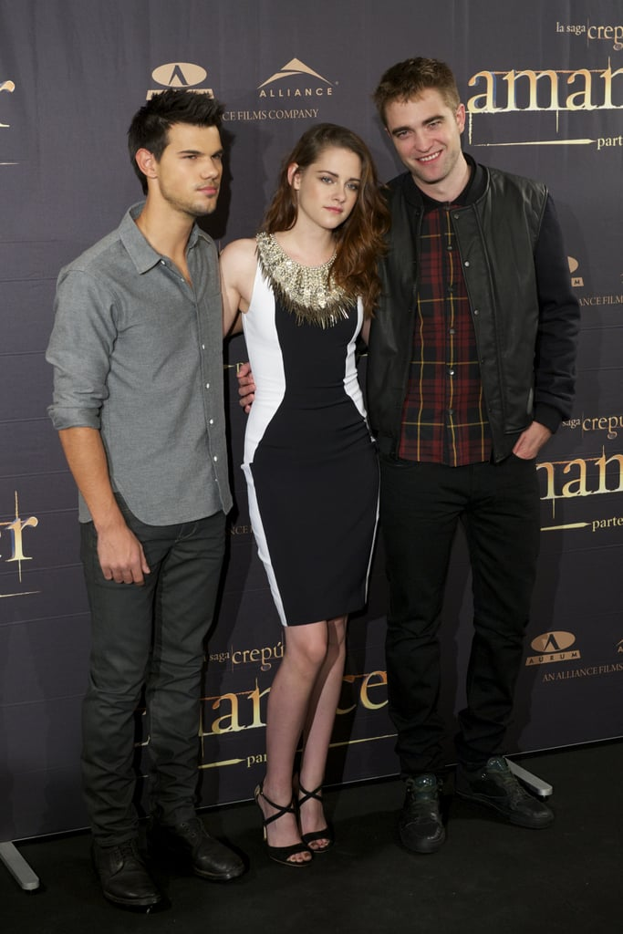 Kristen Stewart and Robert Pattinson continued their Breaking Dawn Part 2 press tour this morning in Spain. They linked up at Madrid's Villa Magna Hotel for a photocall along with Taylor Lautner. Last night, the trio was in the UK for a premiere there. Kristen wore a sexy lace Zuhair Murad jumpsuit to their London event, and changed into jeans and a bomber jacket for their Breaking Dawn afterparty. Today, though, Kristen was a bit more covered up in a black and white Julien Macdonald dress. The next few days will bring Kristen, Robert, and Taylor around Europe in the run-up to the overseas debut of their final Twilight film. Fans in the US, though, will be able to see their finished product starting at midnight tonight.