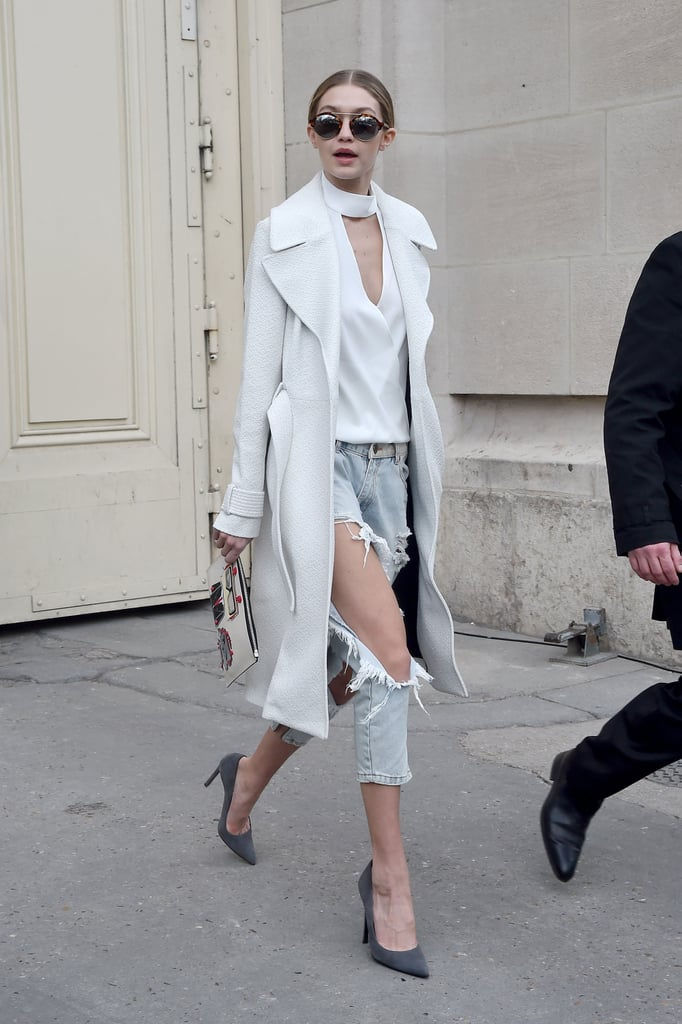 Wearing a distressed pair of One Teaspoon jeans with a cutout top, duster jacket, and pumps.