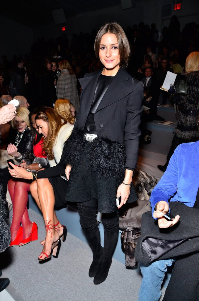 Olivia Palermo mixed a few fabulous trends at Dennis Basso: a cropped fur-trim blazer, textured skater skirt, leather top, and suede over-the-knee boots.