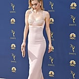 At the Emmy's, Vanessa chose a figure-hugging pink gown with a bustier top by Tom Ford.