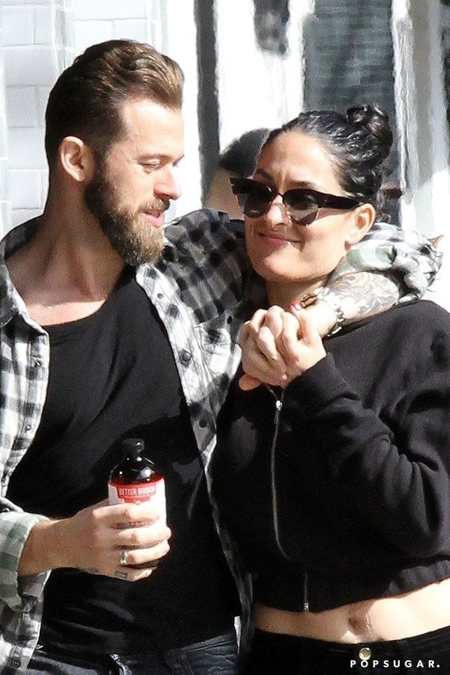 """Things are heating up between Nikki Bella and Artem Chigvintsev, and we're not talking about the dance floor! Following reports that the 35-year-old WWE wrestler had moved on with her former 36-year-old Dancing With the Stars partner after her split from John Cena, the two were spotted on a PDA-filled lunch date at LA's Joan's on Third on Sunday. Nikki and Artem looked smitten as they walked arm in arm, and once inside, they were caught sneaking in a sweet kiss. Sundays are for lovers, right?  Rumours of a romance between Nikki and Artem first began swirling in December after the two were seen together over Christmas weekend. While the two continue to play coy about their relationship status, the DWTS pro recently made a cameo on Nikki's Total Bellas show and he appeared on her Instagram Live over the weekend. """"I have a special guest who had a really fun Sunday fun day with me,"""" she said in the video. So, was this Nikki's way of confirming her romance with Artem? We'll let you decide."""