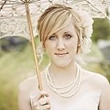 A laced parasol provided a picture-perfect touch to this bride's all off-white ensemble.  Source: Flickr user Ryan Polei