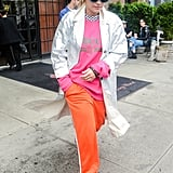 Rita Ora Styled Her Pink Pullover With Orange Sweats
