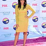 Tia Mowry wore a lemon yellow lace sheath dress paired with nude pumps.