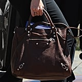 A close-up of Naomi's Balenciaga bag — the rich brown hue lends itself to a Fall sensibility.