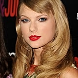 Taylor Swift has a penchant for vintage styles, and her sideswept bangs added a chic element to her brushed-out waves.