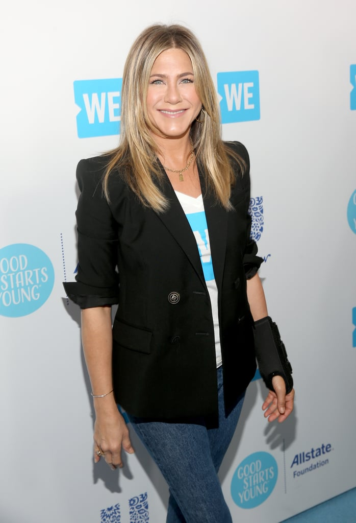 "Jennifer Aniston was a ray of sunshine when she stepped out for WE Day in LA on Thursday afternoon. Clad in jeans and a black blazer, Jennifer was all smiles as she posed on the red carpet, despite her arm brace. The star-studded event honored young people making a difference in their local and global communities and brought out celebrities like Nicole Richie, Selena Gomez, John Stamos, and Morgan Freeman. The event was also special because it marked Jennifer's first red carpet appearance since she and Justin Theroux announced their separation.  Back in February, Jennifer and Justin released a joint statement through her rep, saying that their decision to split after two years of marriage ""was mutual and lovingly made at the end of last year."" Since then, Jennifer has been leaning on her friends for support. In March, she was spotted leaving BFF Courteney Cox's Beverly Hills home, she supported pal Jason Bateman at the premiere of Game Night, and she also helped Jimmy Kimmel's wife, Molly McNearney, ring in her 40th birthday. Over the weekend, she got all glammed up for Gwyneth Paltrow and Brad Falchuk's engagement party. Oh, and if you're wondering how Justin has been since their split, he seems to be doing just fine. Just last week, he was photographed hanging out with a beautiful mystery woman in NYC.       Related:                                                                                                           What Went Wrong? Everything We Know So Far About Jennifer Aniston and Justin Theroux's Split"