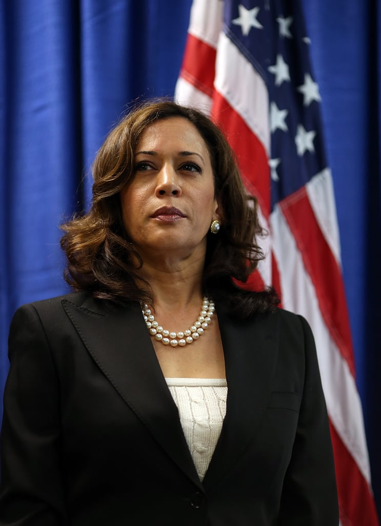 In July 2012, Kamala performed her duty as California attorney general in an ivory cable knit top and a sophisticated black blazer, along with her double strand of pearls.