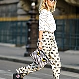 Take polka dots in an edgy direction by teaming with a bolder print in the same color family.