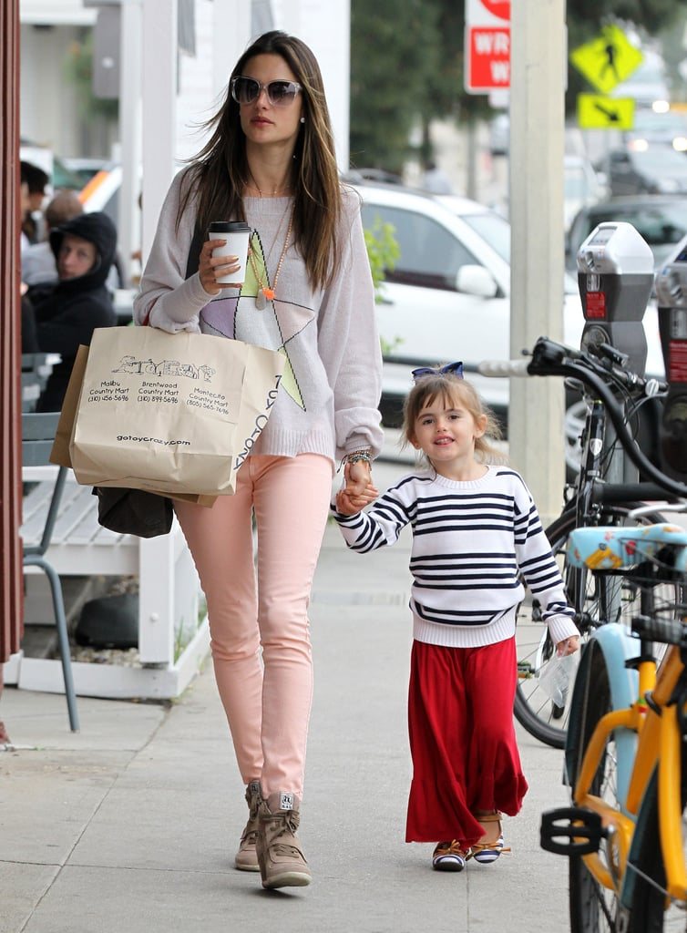 Alessandra Ambrosio took her two children, Anja and Noah, out for a shopping trip in Brentwood on Saturday. She spent the weekend with her family after a busy week working for Victoria's Secret. Last Monday, Alessandra donned a tiny black string bikini for a VS swimwear photo shoot. The following day, she met up with fellow Angels Karlie Kloss and Candice Swanepoel to launch the lingerie line's new beach collection and chat with us about how to wear a bikini.