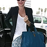 Miranda Kerr was all smiles as she headed into the airport.