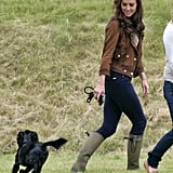 Kate's brown leather coat and work boots made her outfit appear functional.