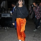 Instead of plain gray sweats, Kourtney upped her outfit with orange track pants.