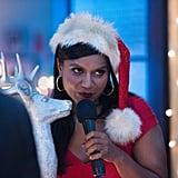 Mindy rocks a sexy Santa look.