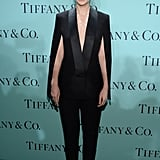 "Carey Mulligan donned a tuxedo look from the Victoria Beckham Fall 2013 collection paired with Saint Laurent ""Janis"" T-strap heels and diamond drop Tiffany & Co. earrings."