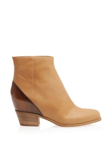 Boots, approx $629, Maison Martin Margiela at MATCHESFASHION.COM