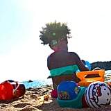 And she played on the beach during her mom's birthday getaway in Corsica.