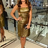 Nikki Reed went for the gold in a Michael Kors dress at the designer's Fashion's Night Out event.