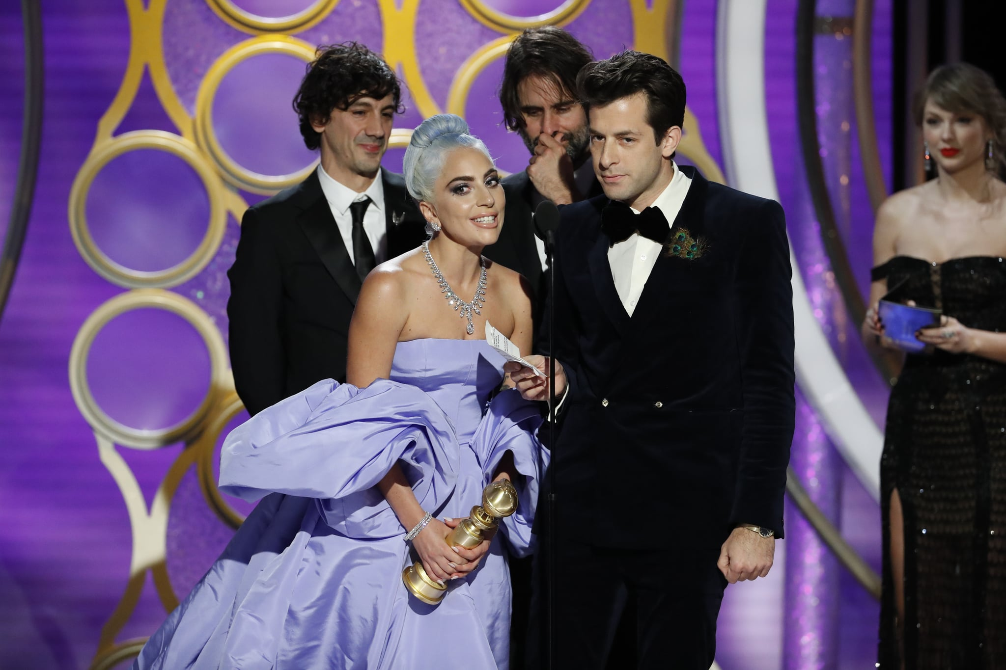 BEVERLY HILLS, CALIFORNIA - JANUARY 06: In this handout photo provided by NBCUniversal, Lady Gaga and Mark Ronson accept the Best Original Song - Motion Picture awards for