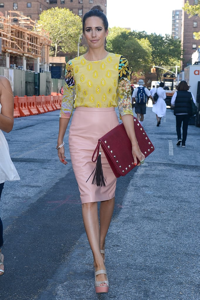 Louise Roe made the rounds with an oversize Valentino clutch in tow.