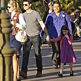 Tom Cruise and Suri Cruise held hands.