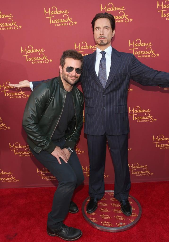 Bradley Cooper had fun with Robert Downey Jr.'s wax figure in LA on Monday.