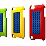 The cases for the 5th-generation iPod Touch have two openings (one for the camera and one for the iPod Touch loop), a rounder backing, and a little less room for Lego building.