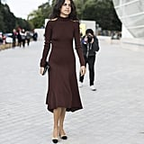 Leandra Medine completed her PFW look with the ladylike shoes.