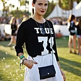 A sporty top met a feminine eyelet skirt and was topped off with a Chanel crossbody bag.
