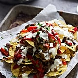 Italian-Style Nachos With Provolone Cheese Sauce, Turkey Sausage, and Roasted Red Peppers
