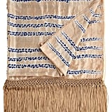 From the fringed detailing to the hand-dyed silk print, this Calypso St. Barth Mojave throw ($225) is the ultimate bohemian-inspired pick.