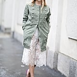 Give lace a modest finish with a buttoned-up jacket on top.