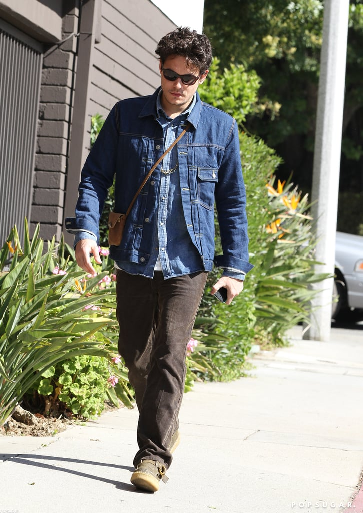 John Mayer walked through Beverly Hills yesterday afternoon sporting a double layer of denim and a small messenger bag. John was without his girlfriend, Katy Perry, for this portion of the romantic holiday at least, but the two have been inseparable lately. Katy and John showed PDA at the Grammys last Sunday, then celebrated music's biggest night at an afterparty with Rihanna, Justin Timberlake, and more stars. The couple also grabbed dinner at Hollywood sushi spot Katsuya with a few friends earlier this week. John, who has been recovering from two vocal surgeries over the last year, is set to start performing again and will go on tour this Summer.