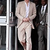 Prince Harry wearing a tan suit.