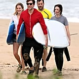 John Krasinski, Emily Blunt, Jimmy Kimmel, and Molly McNearney shared the load of three surfboards.