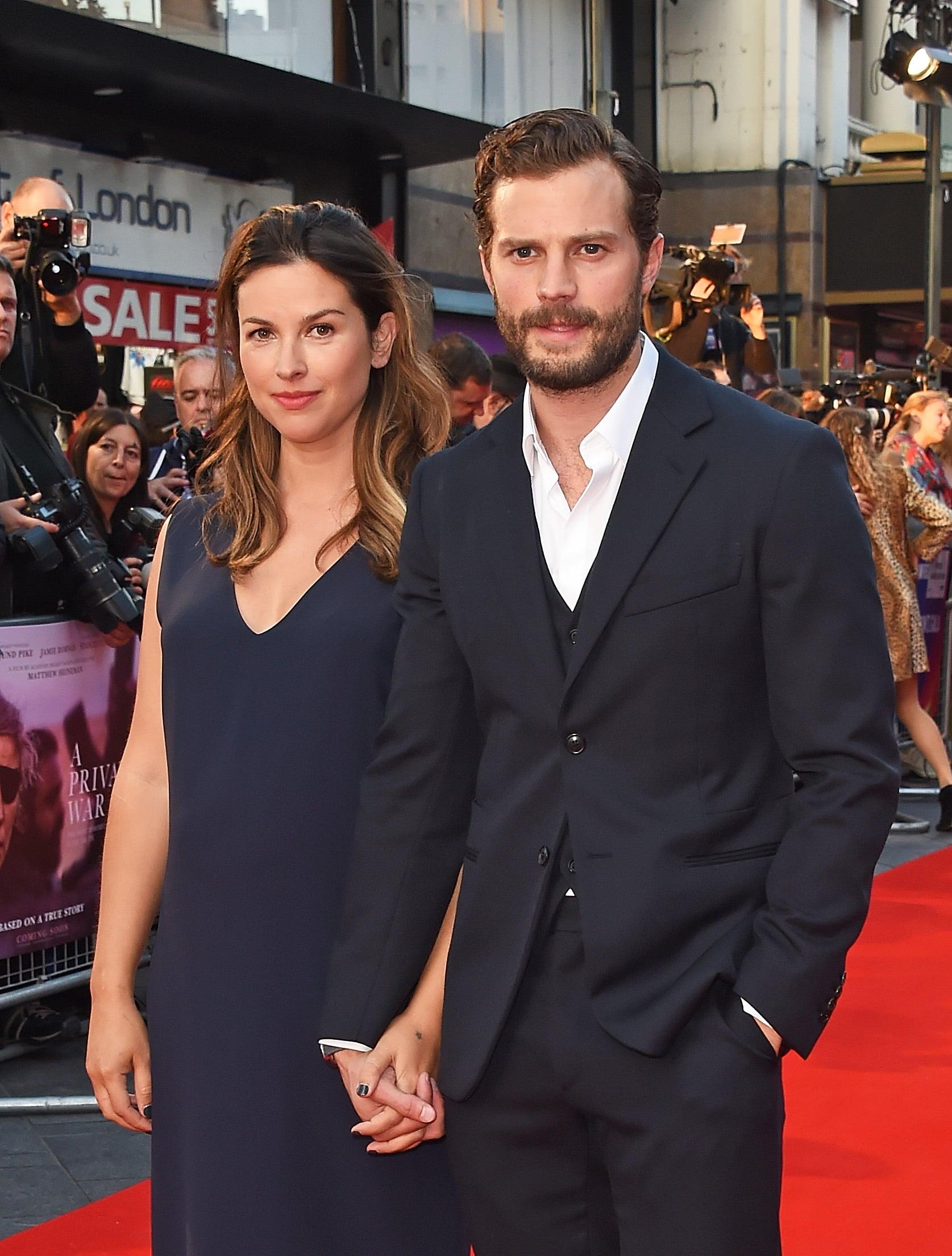 LONDON, ENGLAND - OCTOBER 20:  Amelia Warner and Jamie Dornan attend the European Premiere and Mayor of London Gala screening of