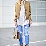 With a silky bomber and slick booties