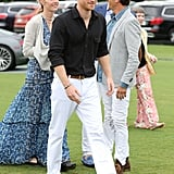 For a day at a polo match, the prince wore a black shirt and white pants.
