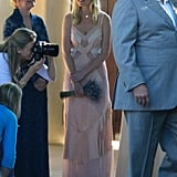 Kirsten Dunst held a bouquet at her friend Molly's July 2012 wedding.