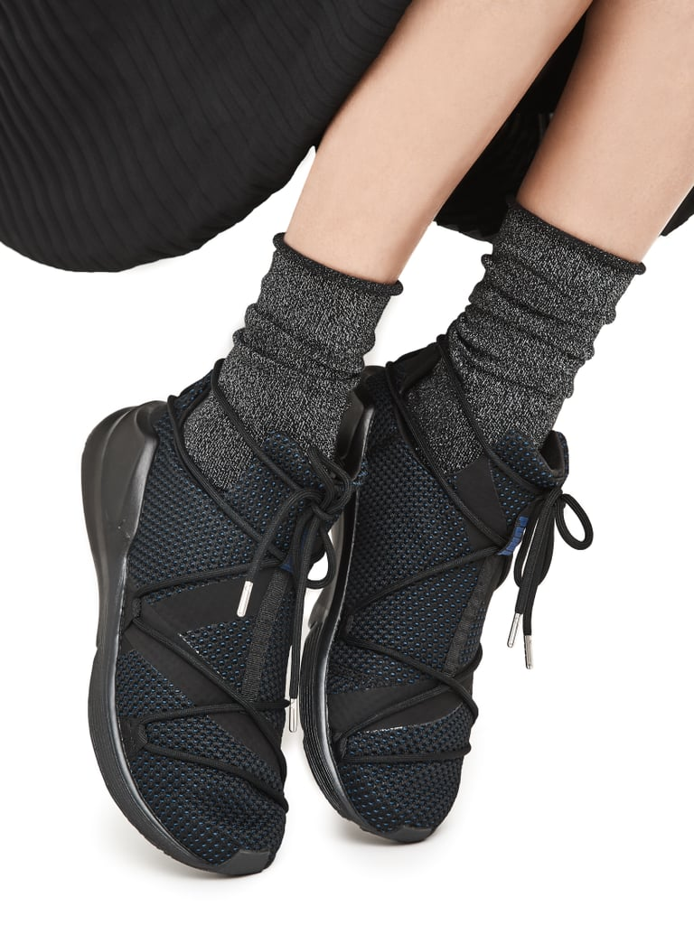 Continue the cool factor by opting for slouchy socks tucked into mesh sneakers rather than reaching for the typical heels or boots.