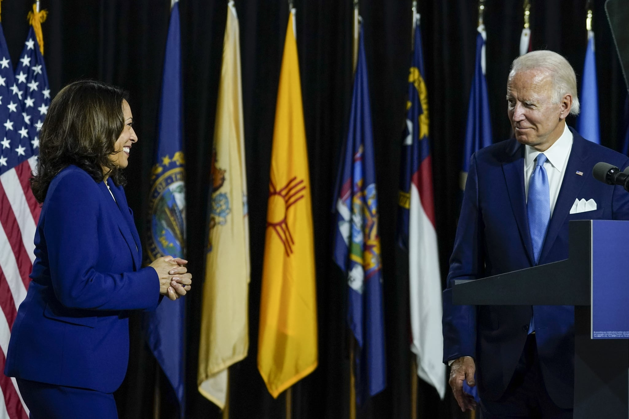 WILMINGTON, DE - AUGUST 12: Democratic presidential candidate former Vice President Joe Biden invites his running mate Sen. Kamala Harris (D-CA) to the stage to deliver remarks at the Alexis Dupont High School on August 12, 2020 in Wilmington, Delaware. Harris is the first Black woman and first person of Indian descent to be a presumptive nominee on a presidential ticket by a major party in U.S. history. (Photo by Drew Angerer/Getty Images)